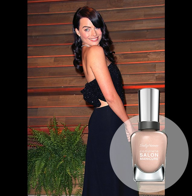 "A brunette Margot Robbie opts for bare-faced beauty and neutral lips at the Vanity Fair Oscar party. <p> <em>Naked Ambition, RRP $14.95</em><br> <a href=""http://en-au.sallyhansen.com/en-au/products/nails/nail-color/complete-salon-manicure-0"" target=""_blank"">Find your colour match from the Complete Salon Manicure Range.</a>"