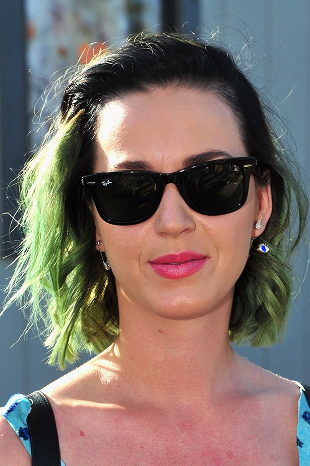 Katy Perry's green cropped-locks were quite the statement on the first day of Coachella. She balanced out the grunge look with a feminine pink lip.