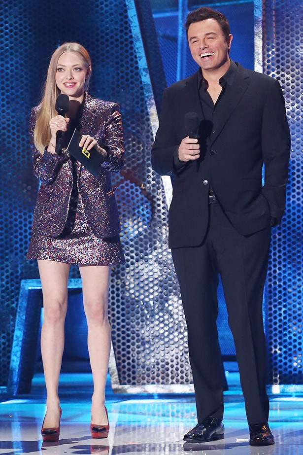 Amazingly, it was good-girl Amanda Seyfried who put a bit of sex into the show, by way of a glittery Saint Laurent look. Seen here with Seth Rogen.