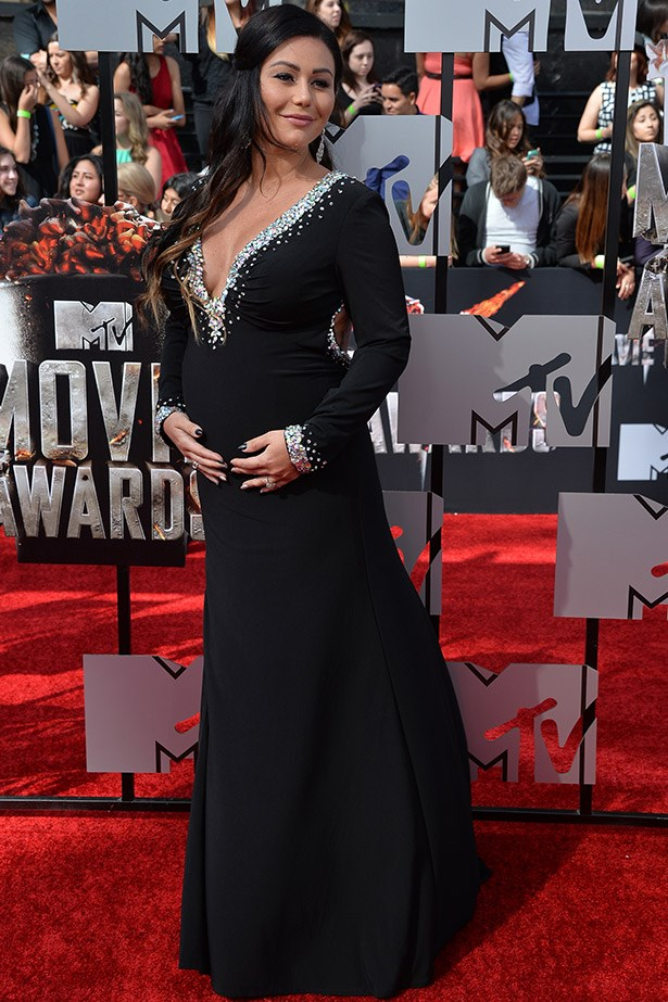 Another pregnant Jersey Shore star covers up. At least JWoww still managed to work in a bit of embellished frosting.