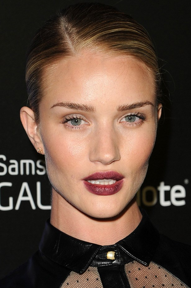 At an event in LA, the British beauty pairs a deep plum lip with a touch of mascara.