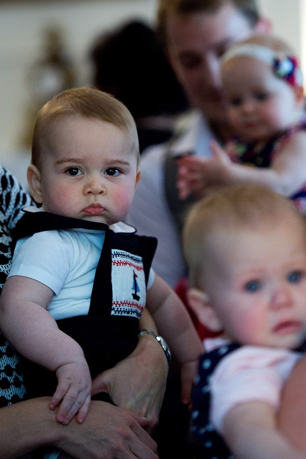 Prince George pulling a very serious royal face among some new friends in Wellington New Zealand.