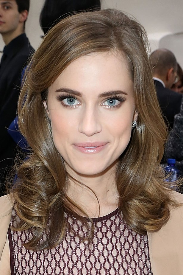 Feminine and pretty, Allison Williams sits front row at Christian Dior's aw14-15 runway.