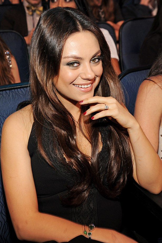 Mila Kunis attended this year's MTV Movie Awards with a sleek middle-part and lustrous waves.
