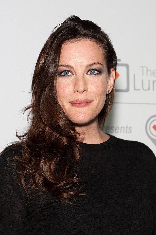 Working the Duchess' signature curls, Liv Tyler attended a fete fundraiser late last year.