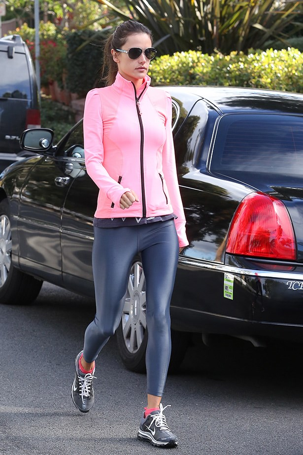 Alessandra Ambrosio keeps things fun in a pink zip-up jacket.