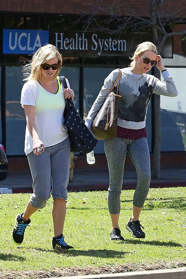 Unlikely gym partners Naomi Watts and Reese Witherspoon in complementary shades of grey.