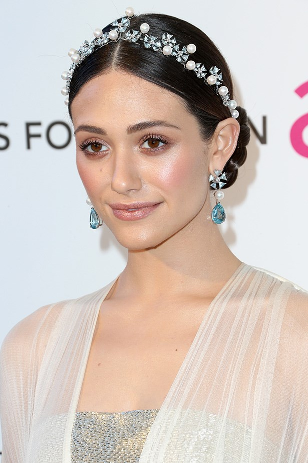 Emmy Rossum wears a stunning crown of crystals and pearls.