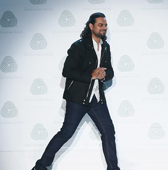 Designer Rahul Mishra takes his bow on the runway in Milan