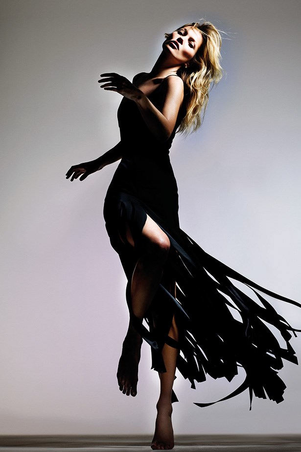 Kate Moss wears a fringe black dress from her new Topshop collection arriving in store and online from 30 April, 2014.