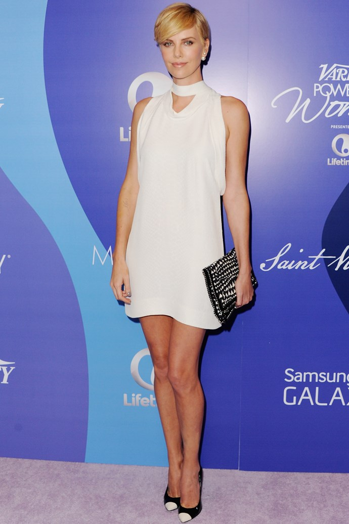Charlize Theron wore her hearts in lieu of sleeves with this Stella McCartney clutch.