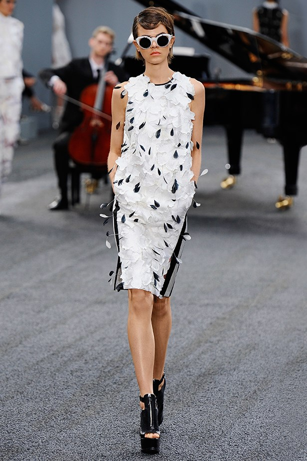 <p><strong>9. Ground a pretty dress</strong></p> <p>Shoe designer Nicholas Kirkwood obviously took one look at Erdem's feathered dresses and saw the writing on the wall. Zippered platforms complete with a chunky plexiglass heel was exactly what this look needed to carry this girl into the 21st century.</p> <p>Erdem SS14</p>