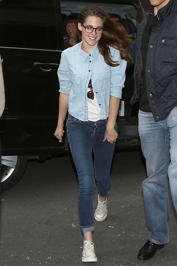 In her off-duty M.O of converse and jeans, Kristen Stewart's buttoned collar and reading glasses take the look into geek-chic territory. Cute.