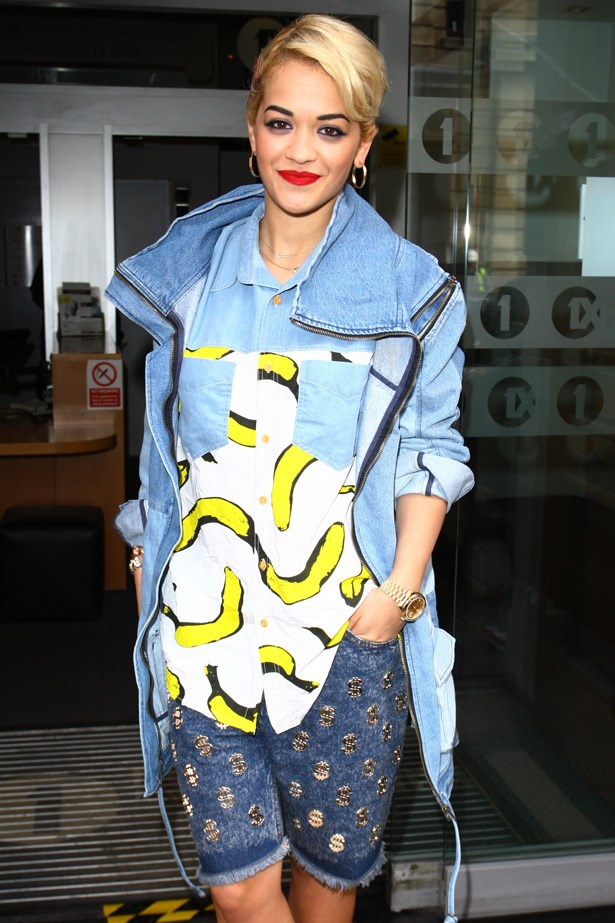Never one to sit on the fence, singer Rita Ora tries her hand at triple denim, mashing banana prints, dollar-sign embellished shorts and an overcoat.