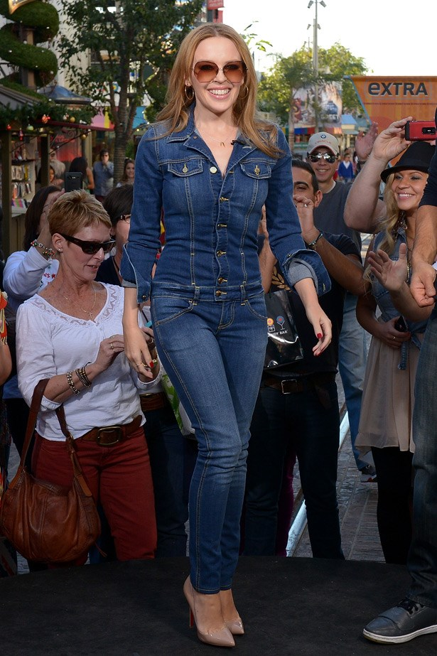 Kylie Minogue shows off her incredible body in this dark denim jumpsuit - a very hard look to ace.