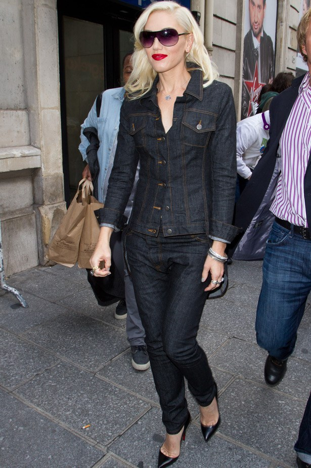 Looking chic in a full dark wash, Gwen Stefani's cool complexion, red lip and silver accessories prevent this from looking too tacky.