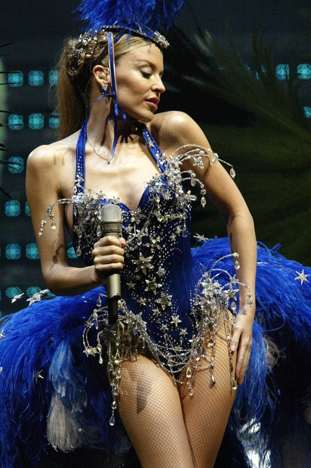Showgirl: The Greatest Hits Tour. Kylie's epic showgirl tour began in early 2005 in Europe, where she wore this spectacular feathered costume designed by John Galliano . It wasn't long after when she was diagnosed with breast cancer and forced to postpone the tour over a year later.