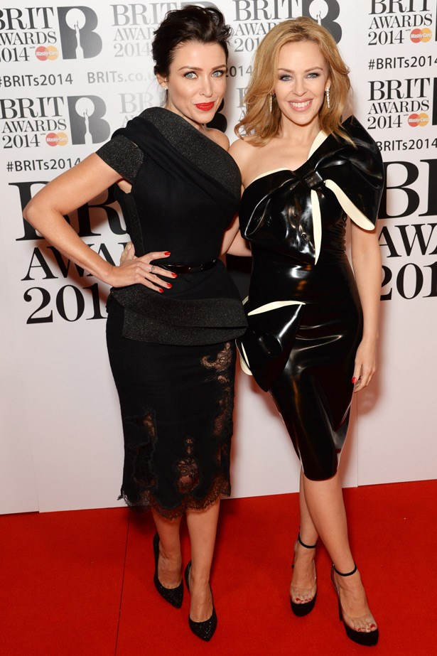 Sisters Dannii and Kylie at the Brit awards. Kylie works an edge with a William Wilde latex dress - a nod to her sexed-up new album, <em>Kiss Me Once.</em>