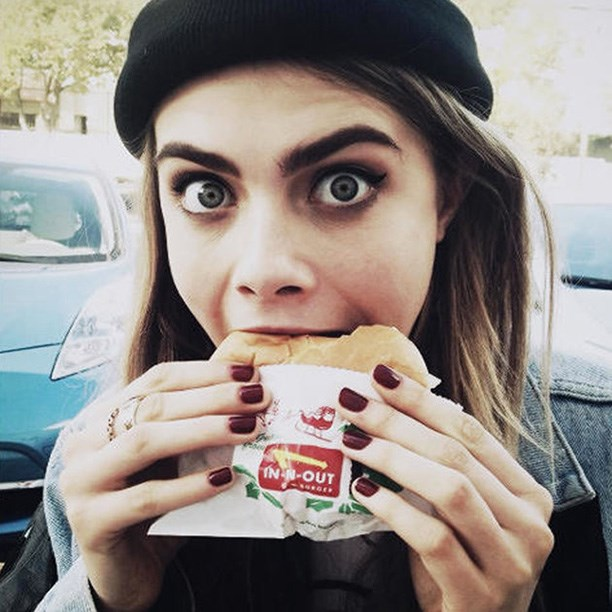 Cara Delevingne chows down on In-N-Out – after taking a moment to share it on Instagram.