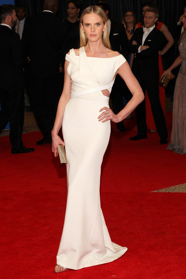 Swimsuit and Victoria's Secret model Anne V in a  Kaufmanfranco gown, with a Calvin Klein clutch.