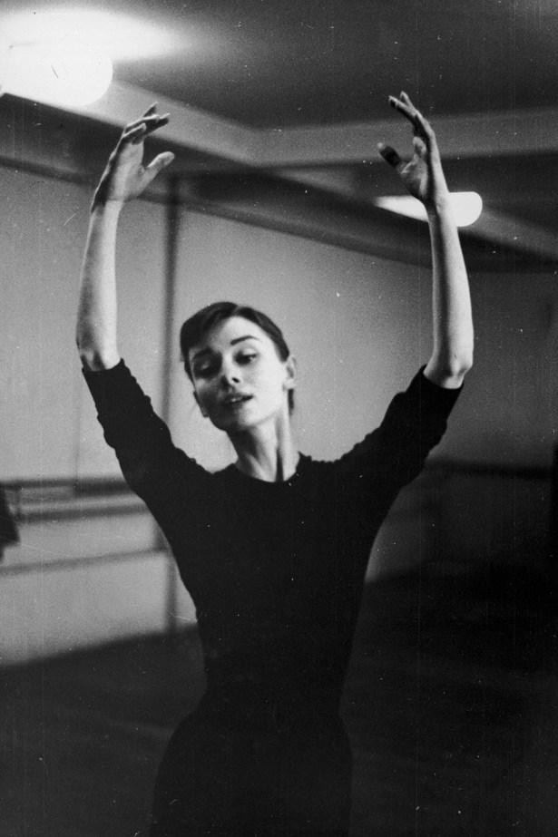 Audrey Hepburn, a classically trained ballerina, dancing in a studio in 1955.