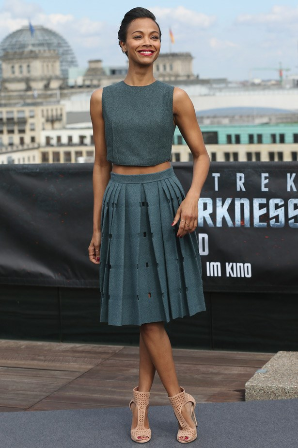 Zoe Saldana's pleated skirt is a nice ladylike alternative to the figure hugging looks we've seen.