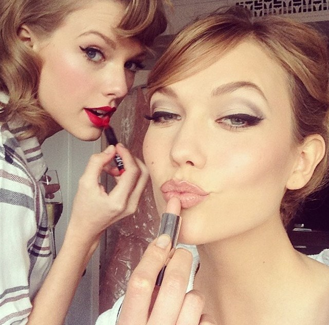 Taylor Swift and Karlie Kloss pull a lipstick selfie.