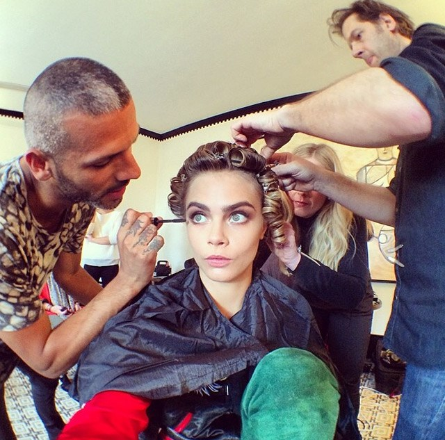 """Cara Delevingne gets made up by her team. <br><br><a href=""""http://www.elle.com.au/runway/runway-report/2013/12/7-reasons-why-we-want-to-be-best-friends-with-cara-delevingne/"""">7 reason's why we love Cara Delevingne </a>"""