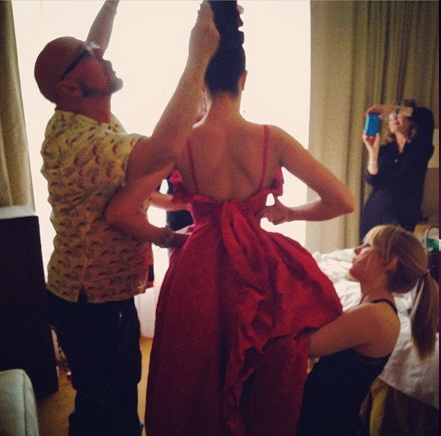 Supermodel Stephanie Seymour and her team of dressers put on the final touches.