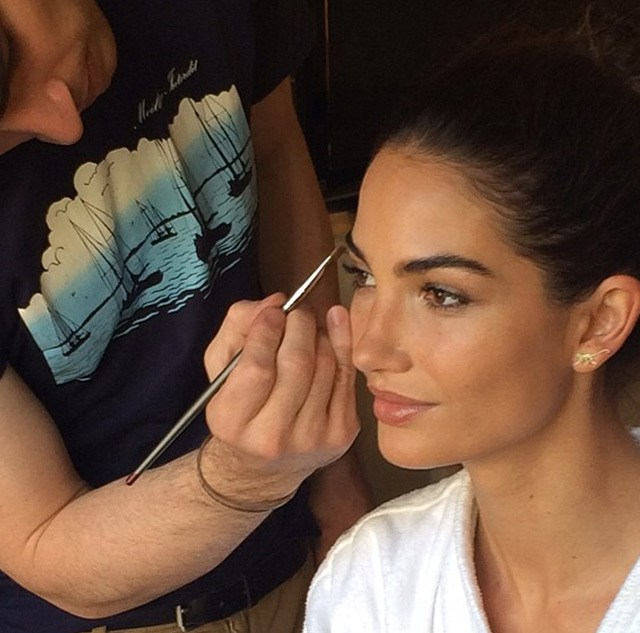 Lily Aldridge getting her makeup done.
