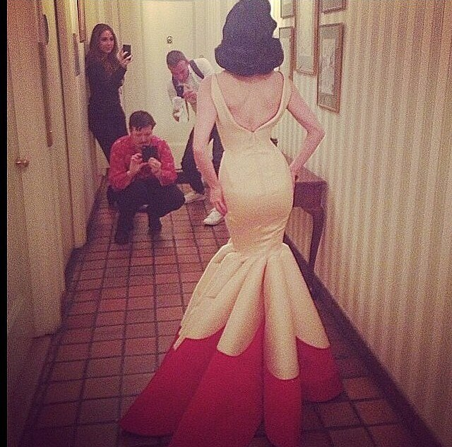 """The back view of Dita Von Teese before she leaves, as her team take some snaps. <strong><br> <br> Related links: <br> <a href=""""http://www.elle.com.au/news/fashion-news/2014/5/white-tie-and-decorations-the-met-gala-red-carpet/"""">See what the stars wore on the red carpet at the 2014 Met Gala </a></strong>"""