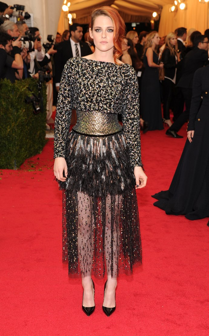 """Face of Chanel's Métiers d'Art Collection Paris-Dallas 2013/14 campaign, Kristen Stewart was dressed by the iconic french house for her Met Gala look. <br><br> Related Links: <br><br> <a href=""""http://www.elle.com.au/news/fashion-news/2014/5/behind-the-scenes-with-karl-and-k-stew/"""">Behind the scenes with Karl and K-Stew</a>"""