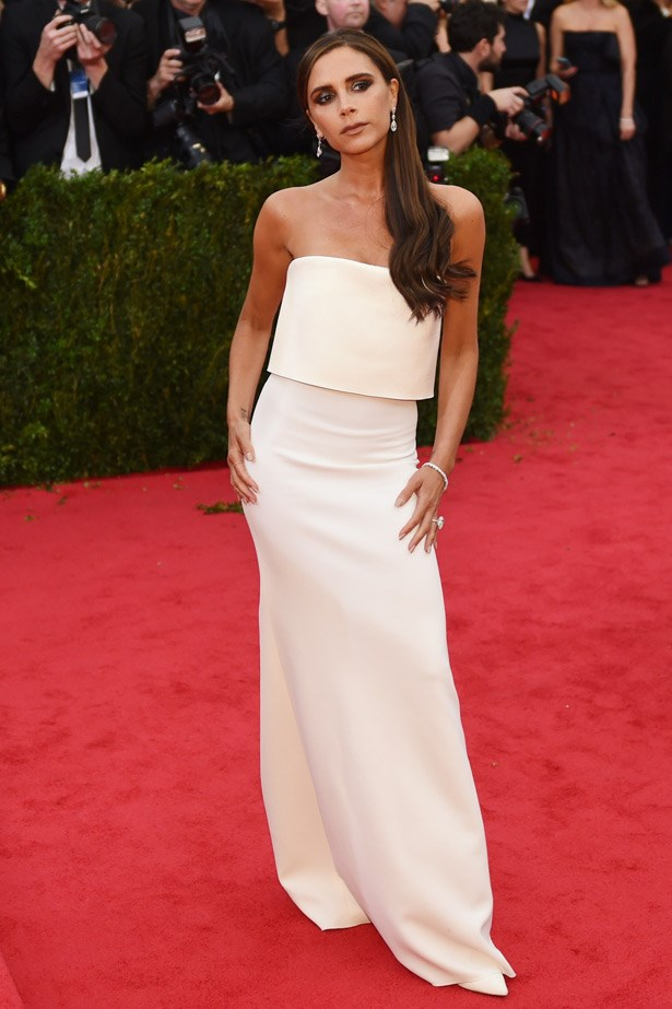 Victoria Beckham looks incredible in a column dress of her own design.