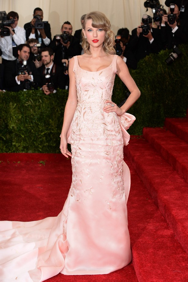 """Taylor Swift in a pink Oscar de la Renta gown. The popstar is reported to have gushed that wearing the designer is a """"dream come true."""""""