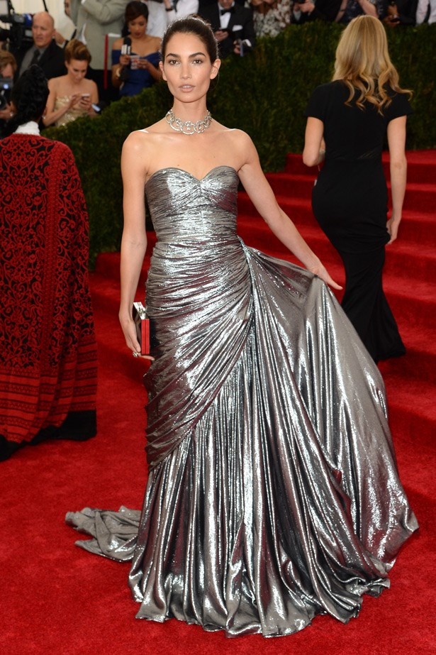 Lily Aldridge glows in a sexy, metallic, strapless gown by Michael Kors.