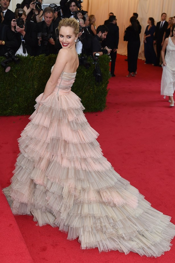 Suki Waterhouse pins her signature fringe back and looks absolutely divine in this layered Burberry gown.
