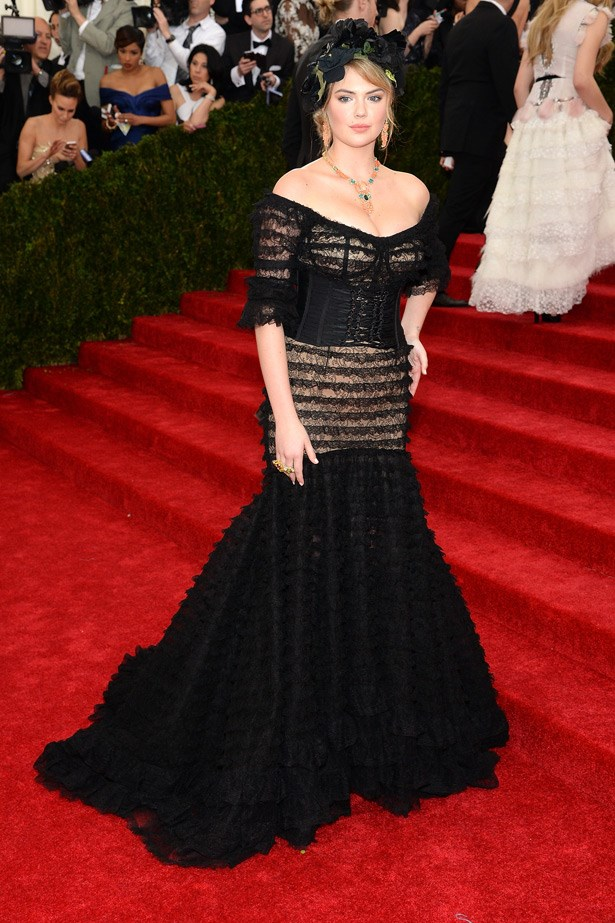 Model and star of <em>The Other Woman,</em> Kate Upton shows off her gorgeous body in a Dolce & Gabbana sheer corseted gown.