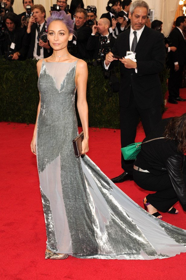 Showcasing her new purple strands, Nicole Richie had bulbs flashing on the red carpet at the Met Gala wearing a backless velvet Donna Karan gown.