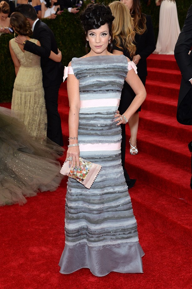 Lily Allen arrived at the 2014 Met Ball wearing a Chanel Haute Couture gown. Allen teamed the custom gown with a fun candy clutch.