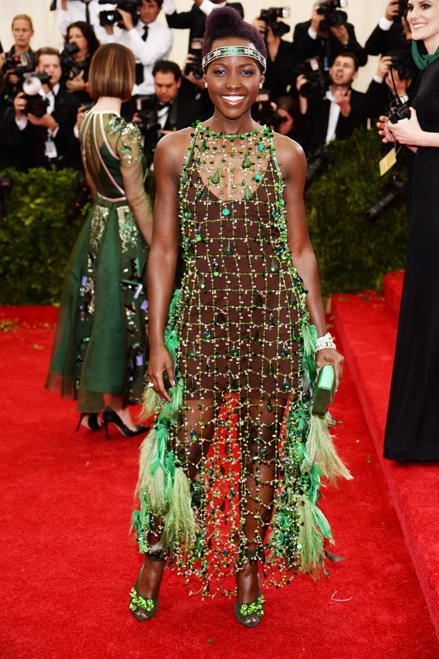 """While """"forest flapper"""" wasn't really part of Charles James' vibe, we still can't help but love Lupita Nyong'o 's Prada look. <br><br> Related Links:<br><br> <a href=""""http://www.elle.com.au/fashion/celebrity-style/2014/3/style-file-lupita-nyongos-bright-fashion-future/""""> Style File: Lupita Nyong'o's bright fashion future</a>"""