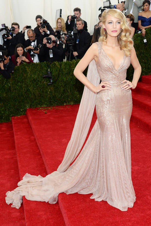 While some of us wonder what Blake Lively is even doing at the Met Ball, others will love her golden Gucci gown.