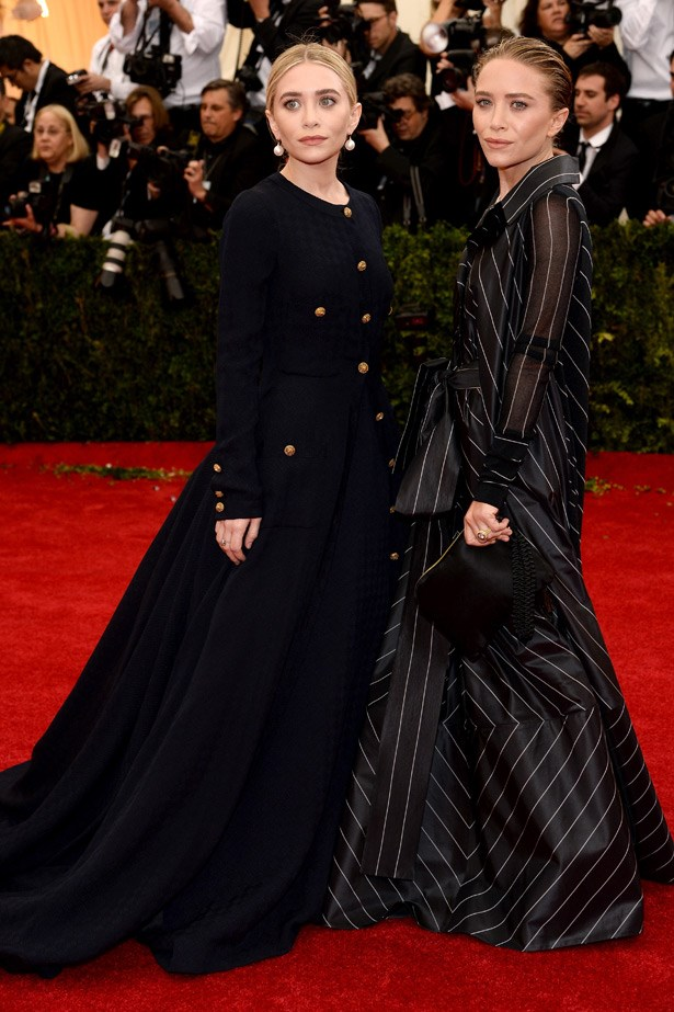 """Mary-Kate and Ashley Olsen look spectacularly moody in their dark, sculptural dresses. Winning. <br><Br> Related Links: <br> <a href=""""http://www.elle.com.au/news/celebrity-news/2014/5/see-inside-mary-kate-olsens-new-home/""""><br> See inside Mary-Kate Olsen's new home</a> <br> <br> <a href=""""http://www.elle.com.au/news/beauty-news/2013/11/olsen-fragrance/"""">Mary-Kate and Ashley Olsen to launch twin fragrances</a>"""