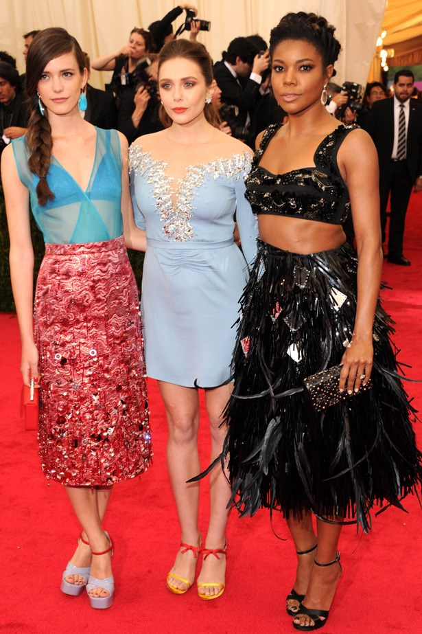 Young blood: Stacy Martin and Elizabeth Olsen in Miu Miu and Gabrielle Union in Prada.