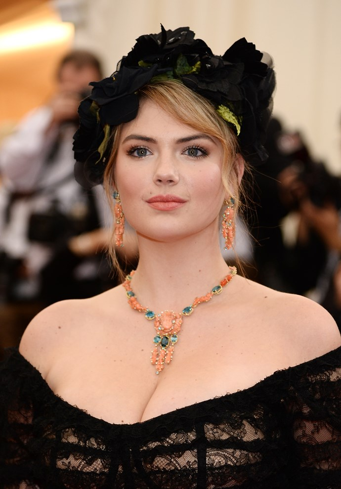 Kate Upton wearing Dolce & Gabbana black chantilly lace dress, accessories and headwear.