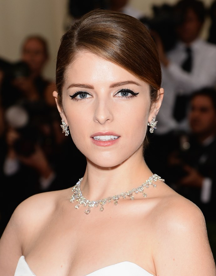 Anna Kendrick wearing a J. Mendel monochrome gown with Graff diamond necklace, earrings and ring, Rauwolf clutch and Brian Atwood shoes.