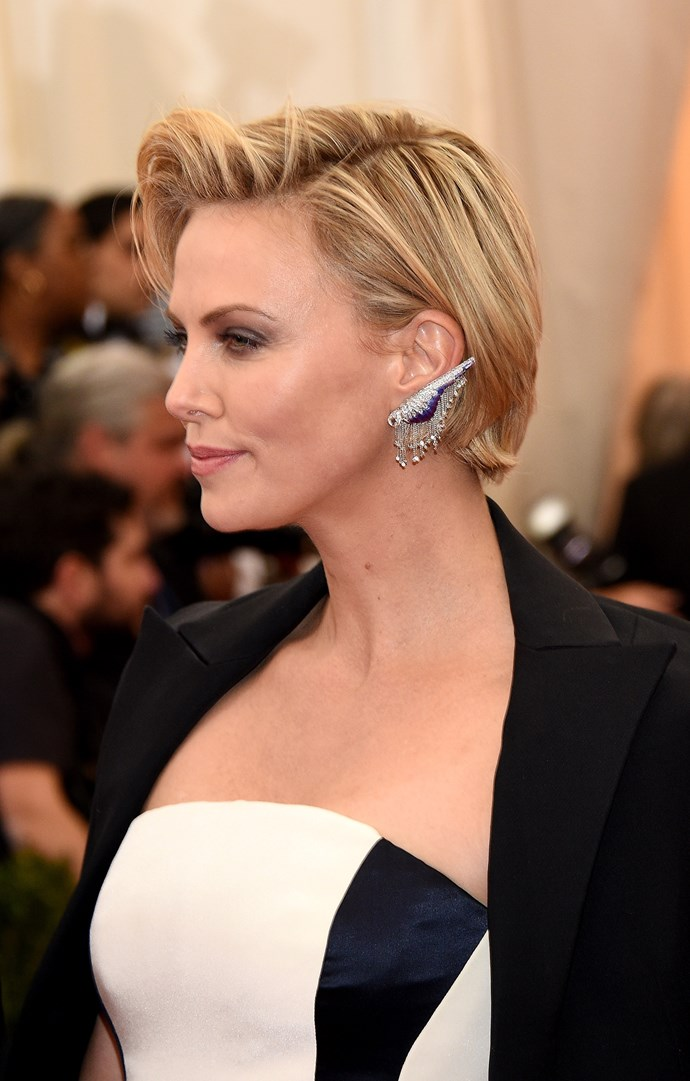 Charlize Theron wearing a Dior Couture gown with vintage Fred Leighton earrings, bracelets and three-stone diamond ring.