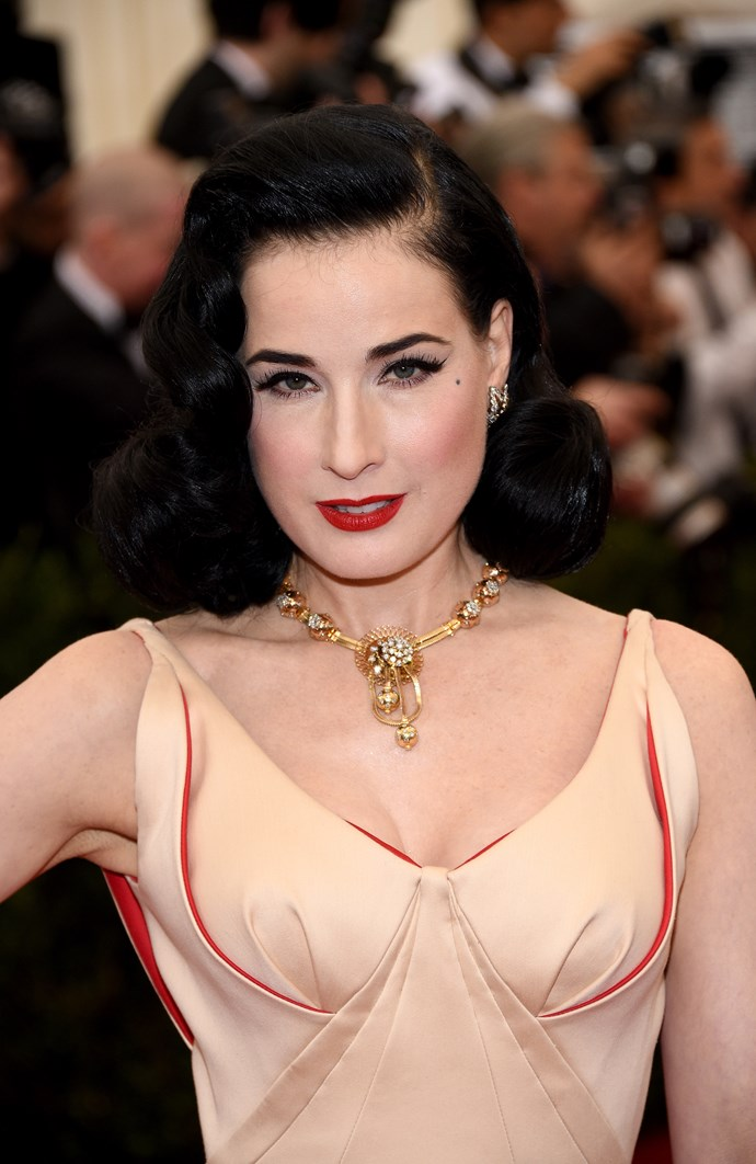 Dita Von Teese wearing a Zac Posen dress with a Van Cleef & Arpels Estate necklace from 1946, Three Leaves Estate earrings and Oiseaux de Paradis ring.