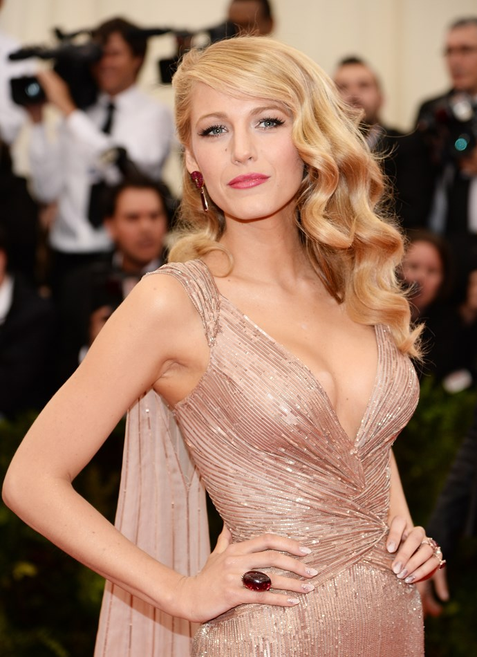 Blake Lively wearing a Gucci Premiere dress with Lorraine Schwartz ruby swirl drop earrings and ruby rings.