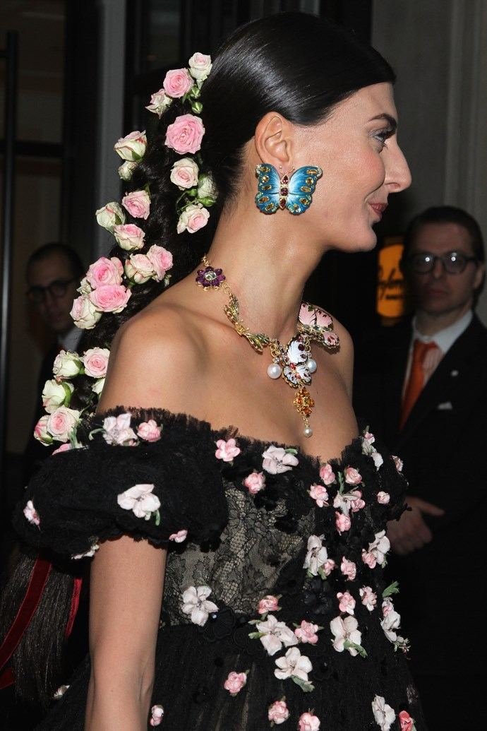 Giovanna Battaglia wearing a Dolce & Gabbana gown, jewellery and flowers.