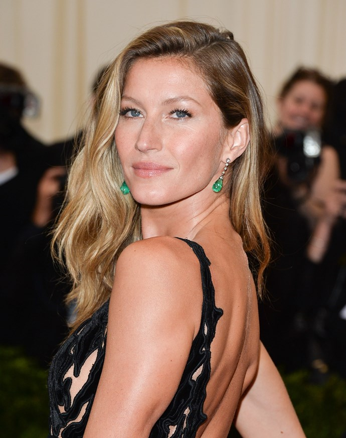 Gisele Bundchen wears Balenciaga dress with Fred Leighton emerald and diamond drop earrings.